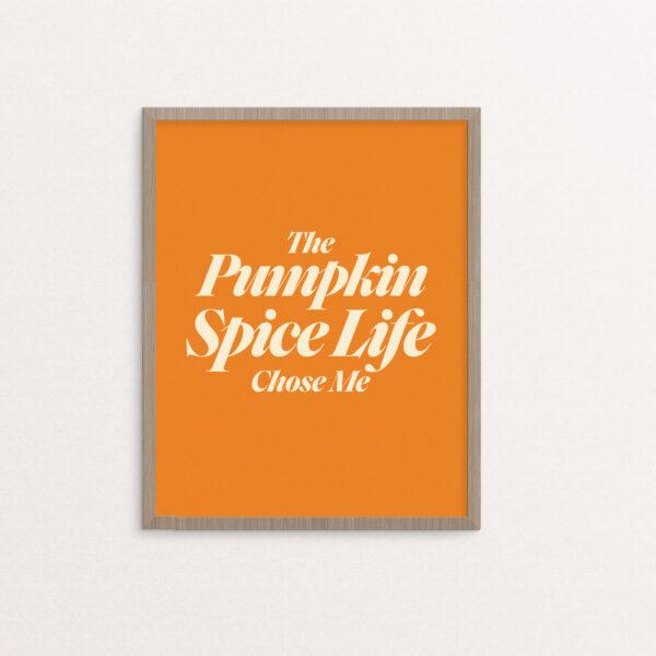 The Pumpkin Spice Life Chose Me in serif type in creme on a pumpkin orange background